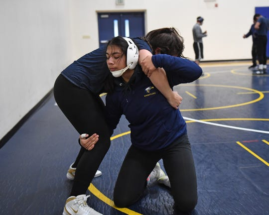 Martinez' teammate Elena Felix, a standout wrestler in the 152-pound bracket, has helped her development this season.
