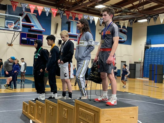 Palma's Zak Thompson (far right) earned enough votes for boys' athlete of the week after finishing second in the PCAL finals' 113-pound weight class.