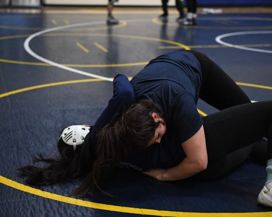 Everett Alvarez wrestler Melanie Martinez (top) earned enough votes to win the girls' Athlete of the Week award on the way to her no. 1-seed in the CCS tournament.