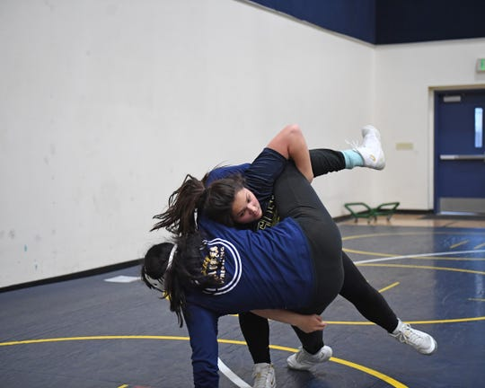 Martinez (top) trained hard in the offseason to improve her strength on the mat and it's paid off to the tune of big wins, including one against Alisal's Marisol Licea.