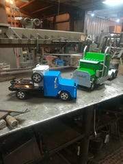 A pickup truck and semi truck are ready to be shipped out from The Happy Toy Maker workshop in Happy Texas.  The pickup truck weighs around 20 lbs.