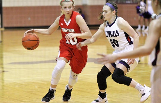 Christoval's Allison Vaughn is guarded by Roscoe's Sadie McCambridge in a Class 2A bidistrict girls basketball playoff Monday, Feb. 11, 2019, at Bronte.