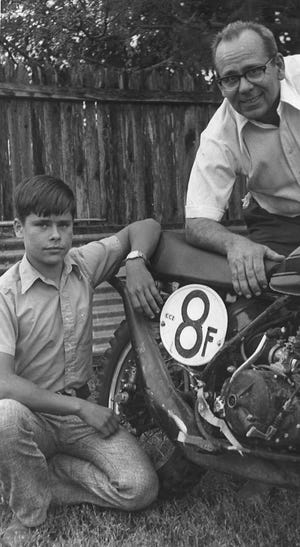 Frank Deloria with his son Ted next to a motorcycle.