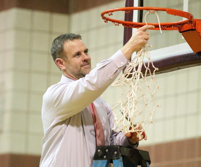Christoval head girls basketball coach Scott Richardson finishes off cutting down the net after beating Roscoe in a Class 2A bidistrict playoff Monday, Feb. 11, 2019, at Bronte.