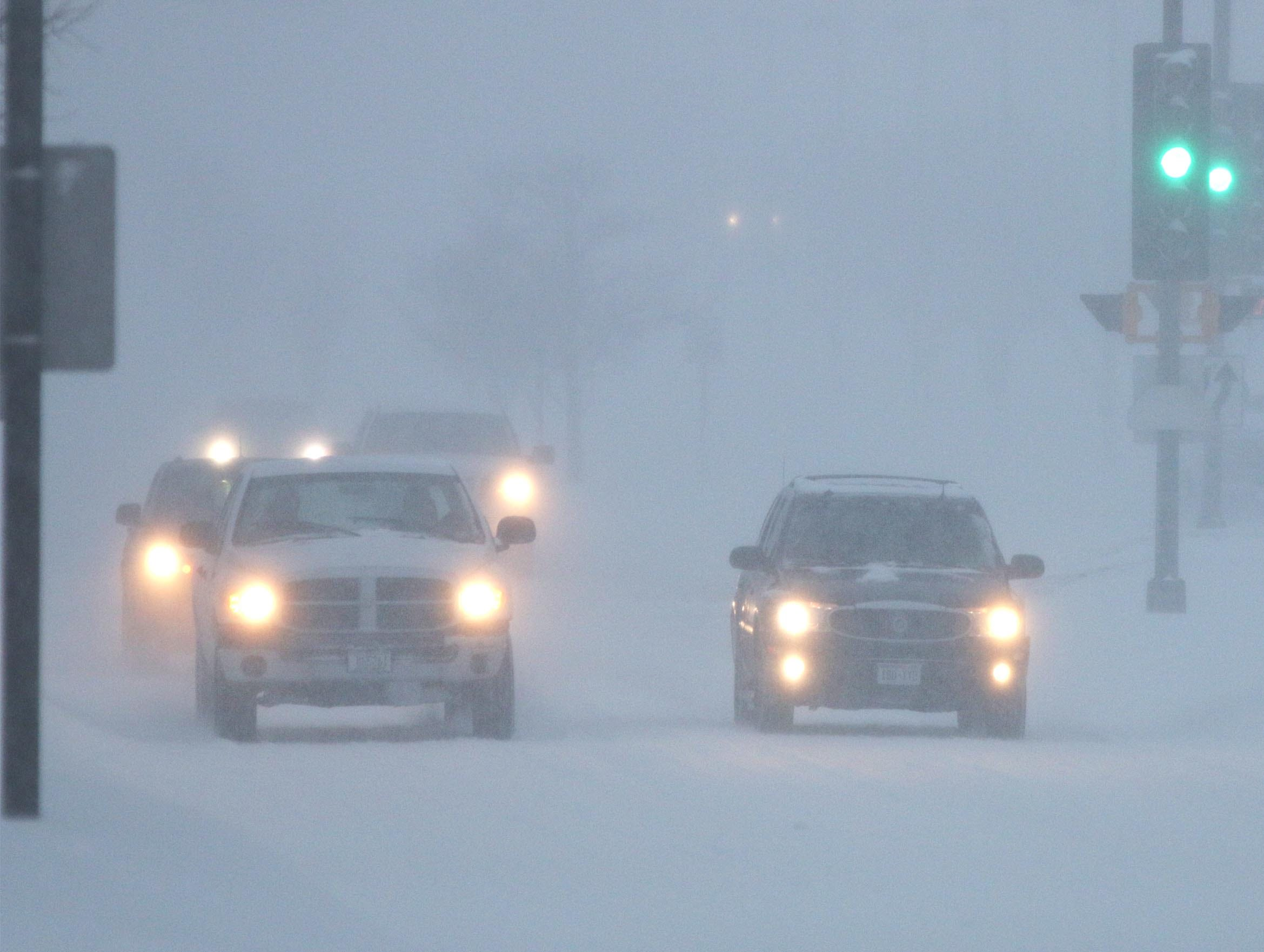 Drivers found limited visibility on Kohler Memorial Drive, Tuesday, February 12, 2019, in Sheboygan, Wis. Snows closed many schools and activities.