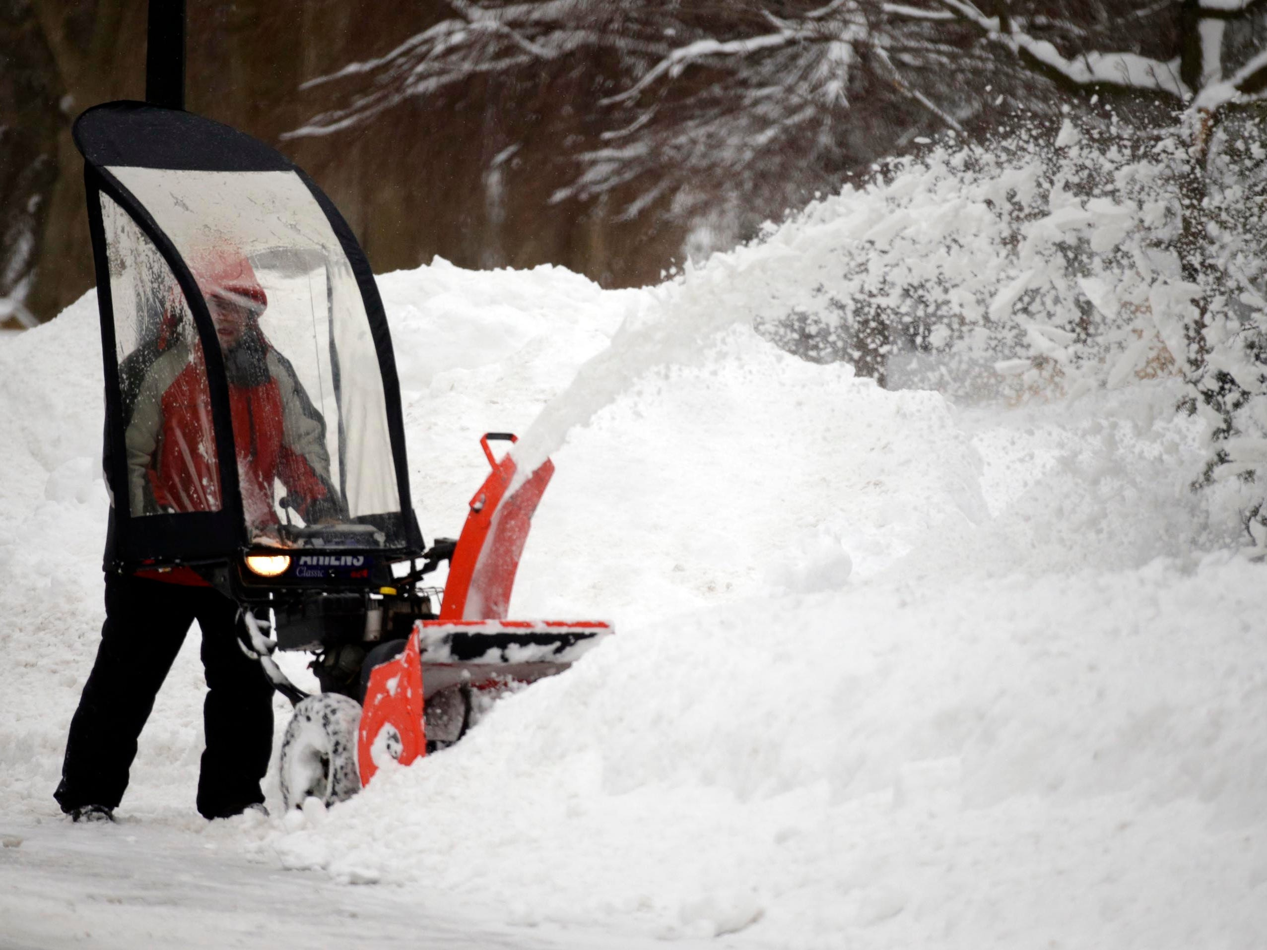 David Weinhold of Sheboygan Falls, removes snow from his driveway, Tuesday, February 12, 2019, in Sheboygan Falls, Wis.
