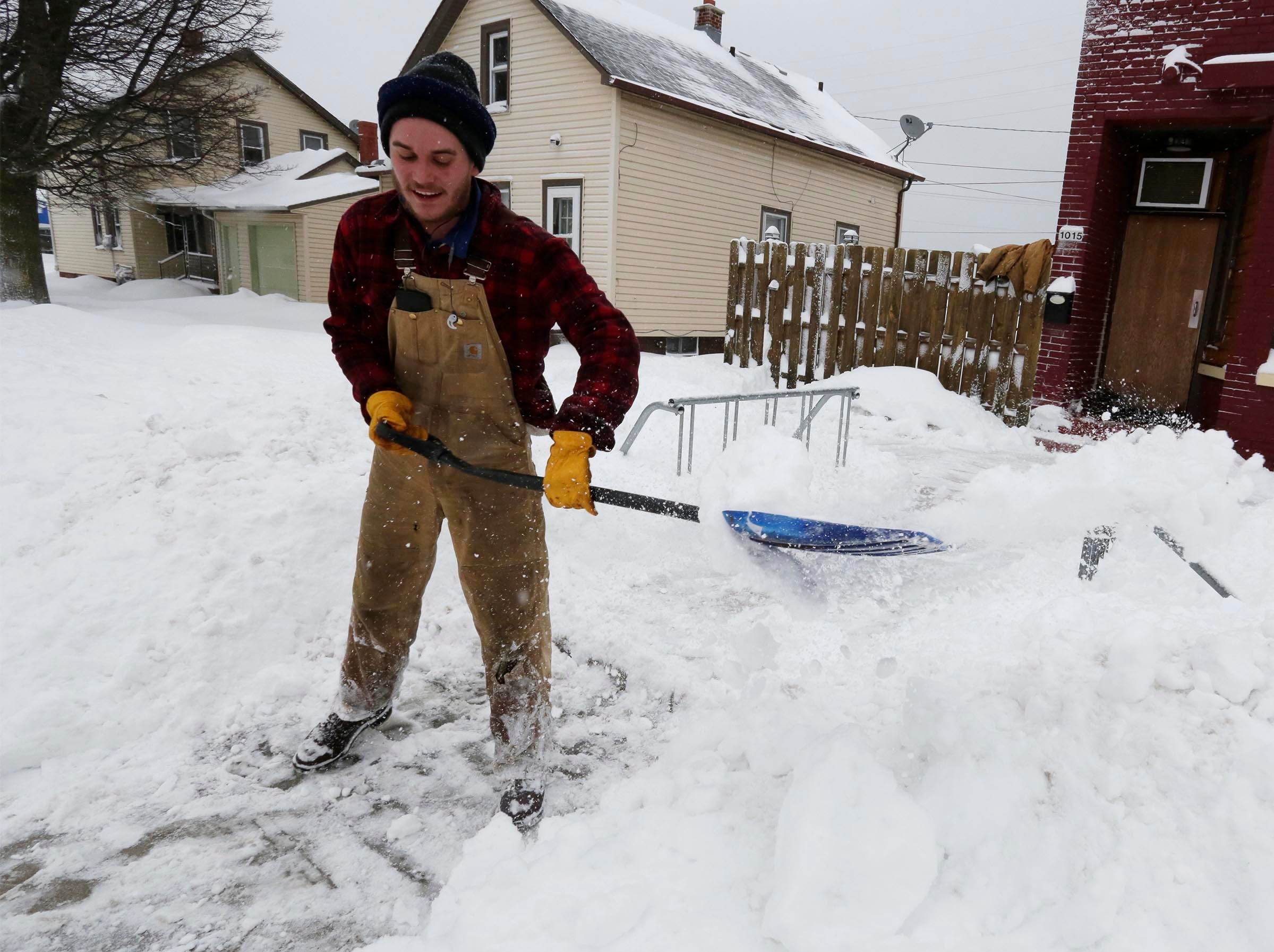 "Robert Bachmann of Sheboygan shovels snow in front of Craft 30 on South 10th Street, Tuesday, February 12, 2019, in Sheboygan, Wis. ""Bachmann said, ""I got a car in the ditch, but at least I have a four-wheel-drive truck for this."""