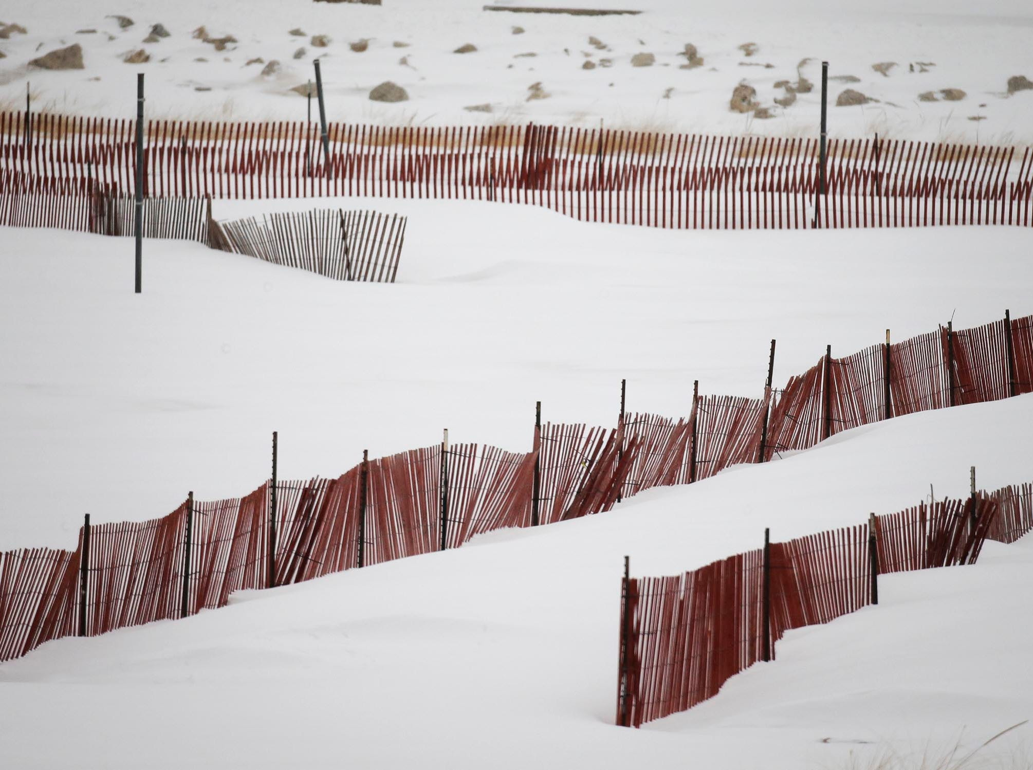 Snow fences contrast with the freshly fallen snow at Deland Park, Tuesday, February 12, 2019, in Sheboygan, Wis.