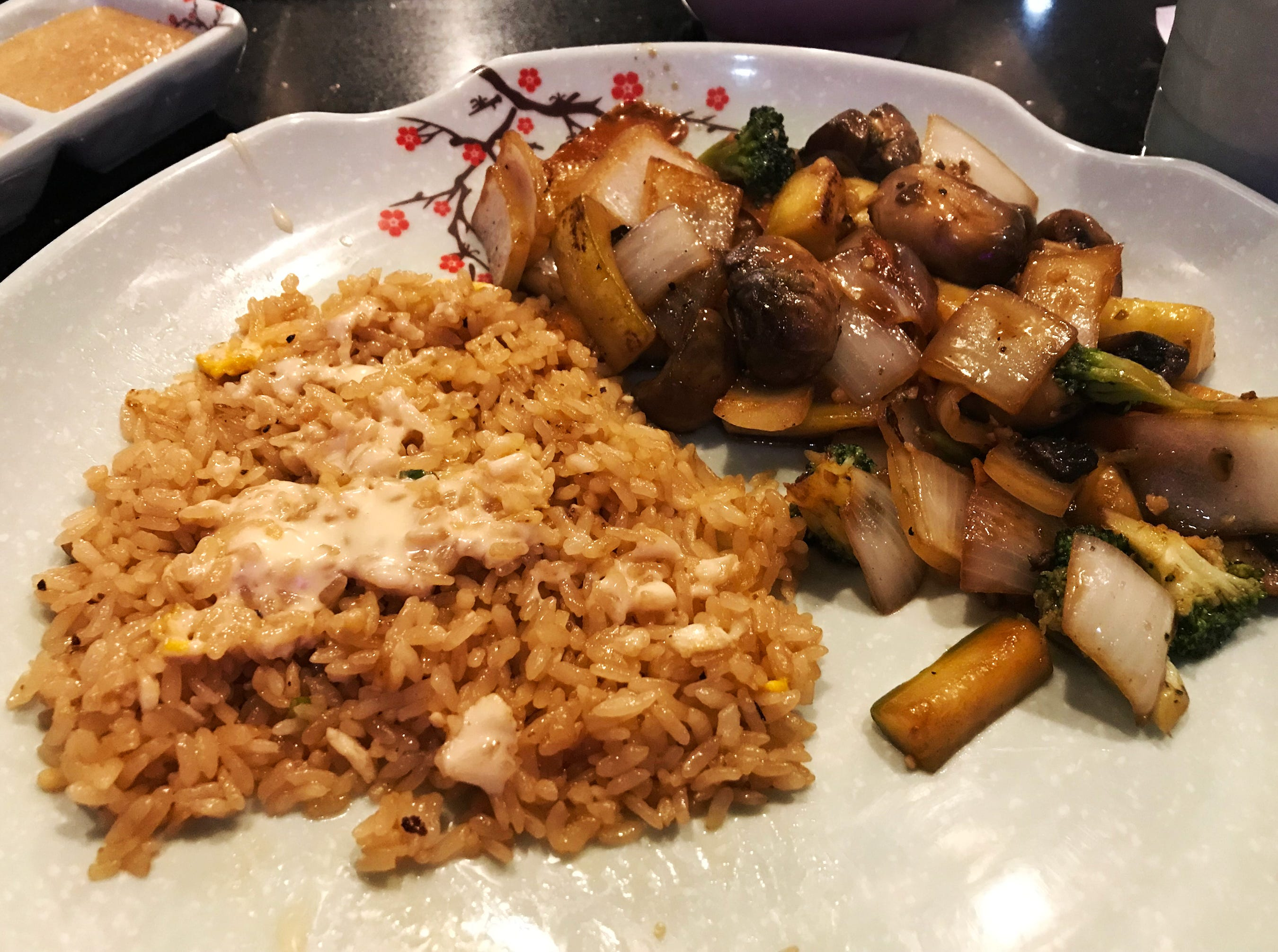 Fried rice and grilled vegetables at the Umi Sushi And Steak House, Thursday, January 31, 2019, in Sheboygan, Wis.