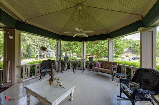 The porch is able to hold a large crowd and is perfect for enjoying mint juleps with guests.