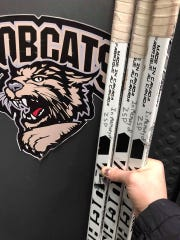 Former Mudbugs goalie John Roberts used a message on his sticks to remember friend and protege Solan Peterson.