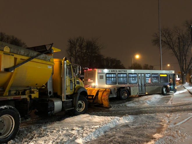 ASioux Falls Public Works snow plow ran into a Sioux Area Metro bus at the intersection of Prairie Avenue and 11th Street Wednesday night.