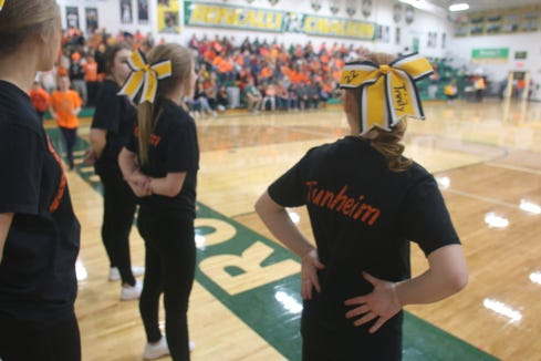 Cheerleaders from Groton wore special shirts in memory of Ava Tunheim during Monday night's basketball game against Aberdeen Roncalli.
