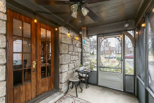 Guests can enjoy a comfortable screened-in porch just off the living room.