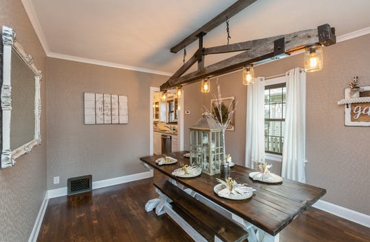 The light fixture Cindy designed from old trusses and a metal bed frame is the focal point in the dining room.