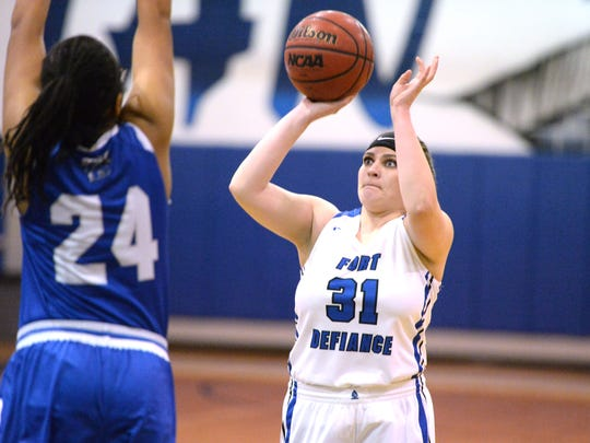 Fort Defiance's Cailin Wright puts up a shot over Monday night in the Valley District girls basketball semifinals.