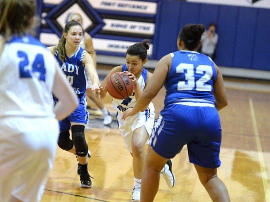 Fort Defiance's Kiersten Ransome dribbles past a pair of Rockbridge defenders Monday night in the Valley District girls basketball semifinals.