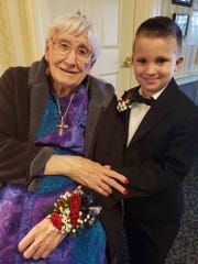 Five-year-old Ford Henry Young and his 98-year-old great-grandmother Helen Jones pose for a photo at the Stuart Hall Sweethearts Dance on Feb. 8, 2019.