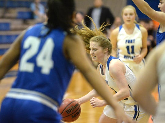 Fort Defiance's Brianna Allen works the ball through the Rockbridge defense Monday night in the Valley District girls basketball semifinals.