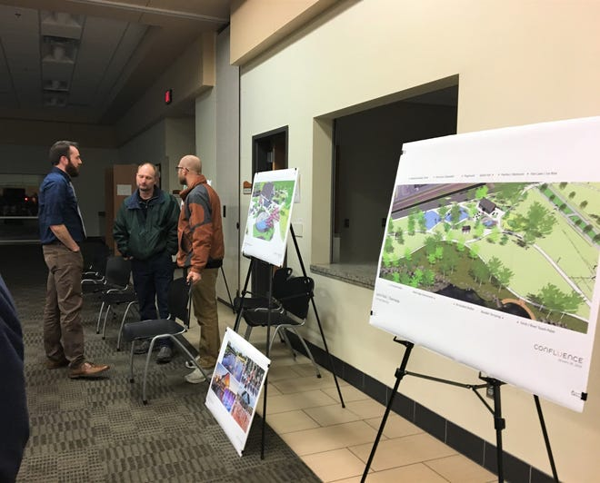Residents discuss the plans for Southside and Lions parks with Council Member Nick Sauer at the Sauk Rapids Government Center, Feb. 11, 2019.