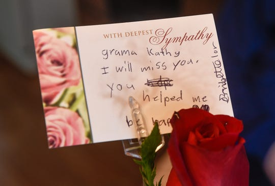 A rose and handwritten note are from students in a class where Kathy Wingen served as a foster grandparent.
