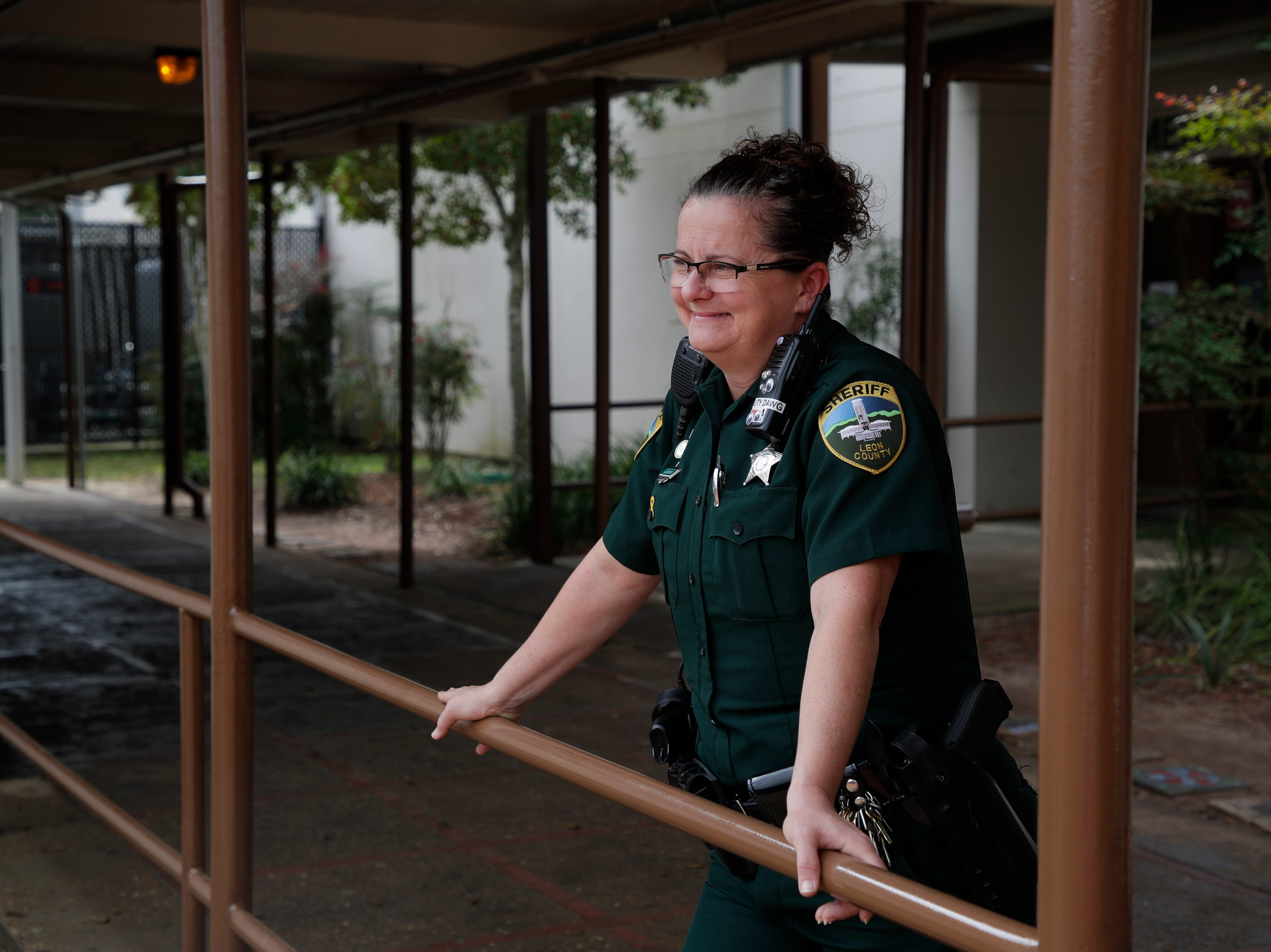 Leon County Sheriff's Department Deputy Jennifer Morris, school resource officer at Cobb Middle School, watches as students head to class after lunch Tuesday, Feb. 12, 2019.