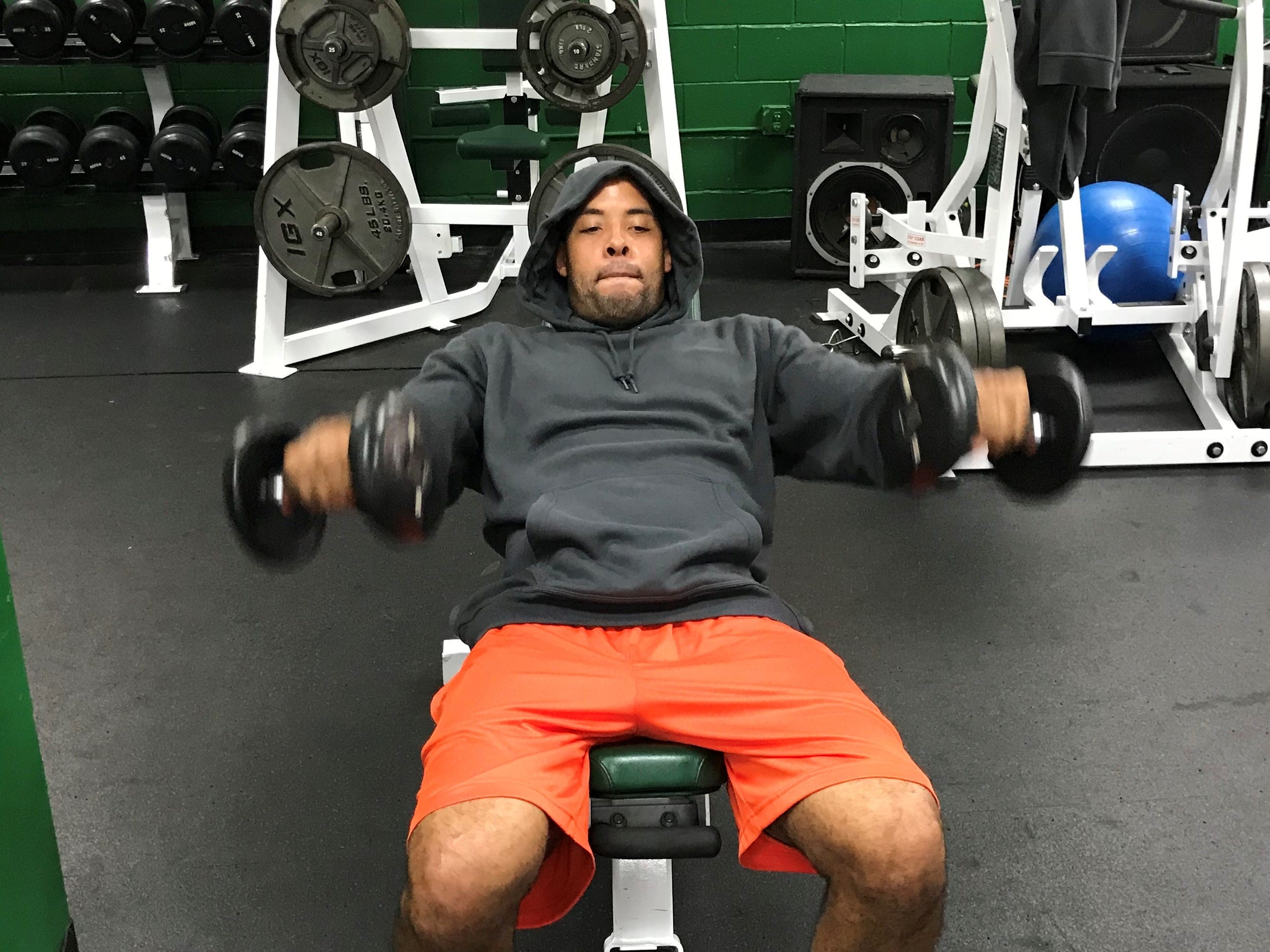 FAMU defensive backs coach Brandon Sharp leads by example and trains in the weight room with players.