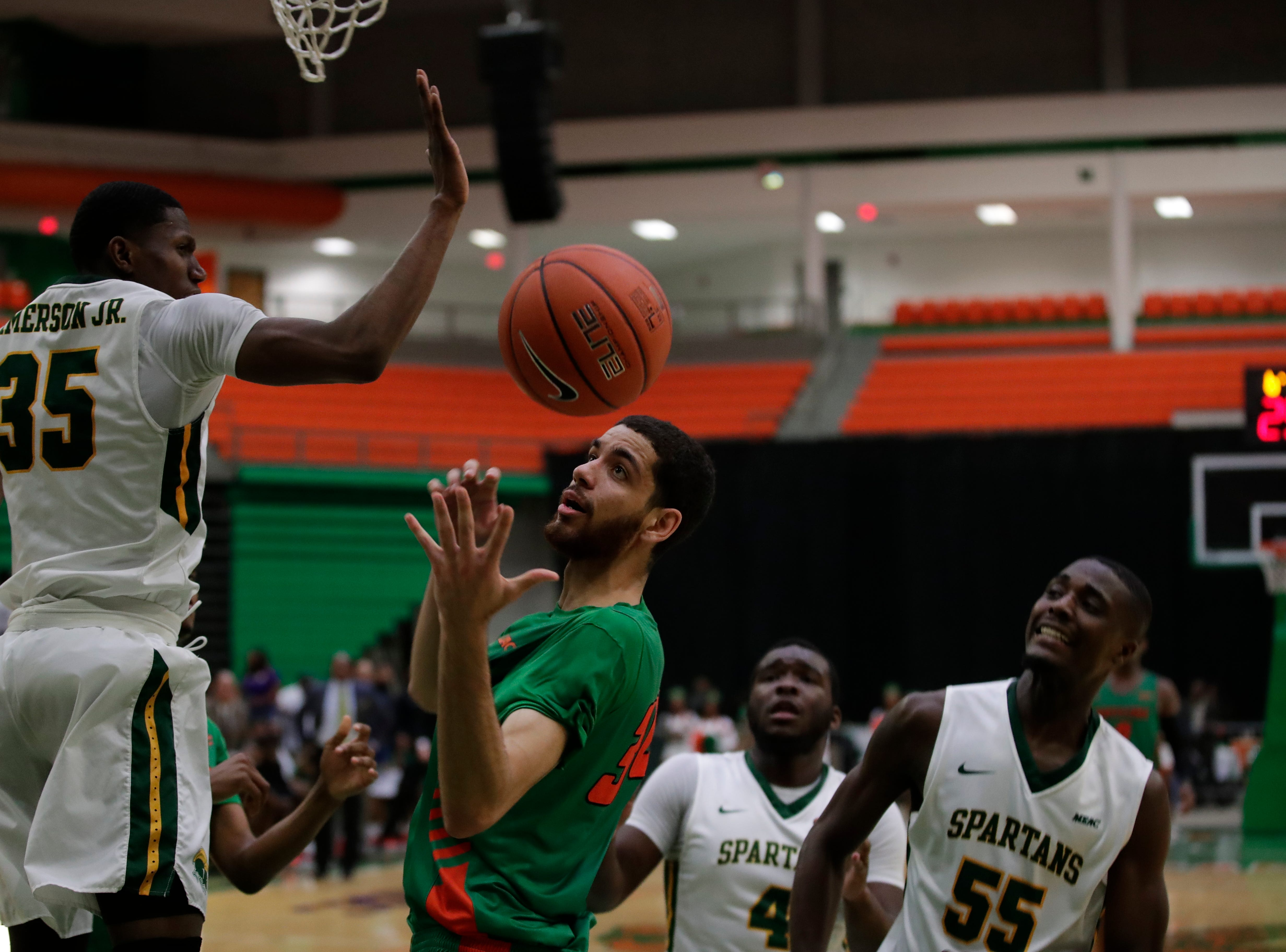 A rebound slips from the hands of Florida A&M Rattlers center Isaiah Martin (34) during a game between FAMU and Norfolk State at the Alfred Lawson Jr. Multipurpose Center Monday, Feb. 11, 2019.