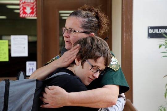Leon County Sheriff's Department Deputy Jennifer Morris, school resource officer at Cobb Middle School, hugs sixth grader Jake West in the hall between classes Tuesday, Feb. 12, 2019.