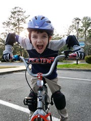 Corbett Howell has mastered cycling and will be riding in the Hang Tough Foundation's Champions Ride on Saturday.