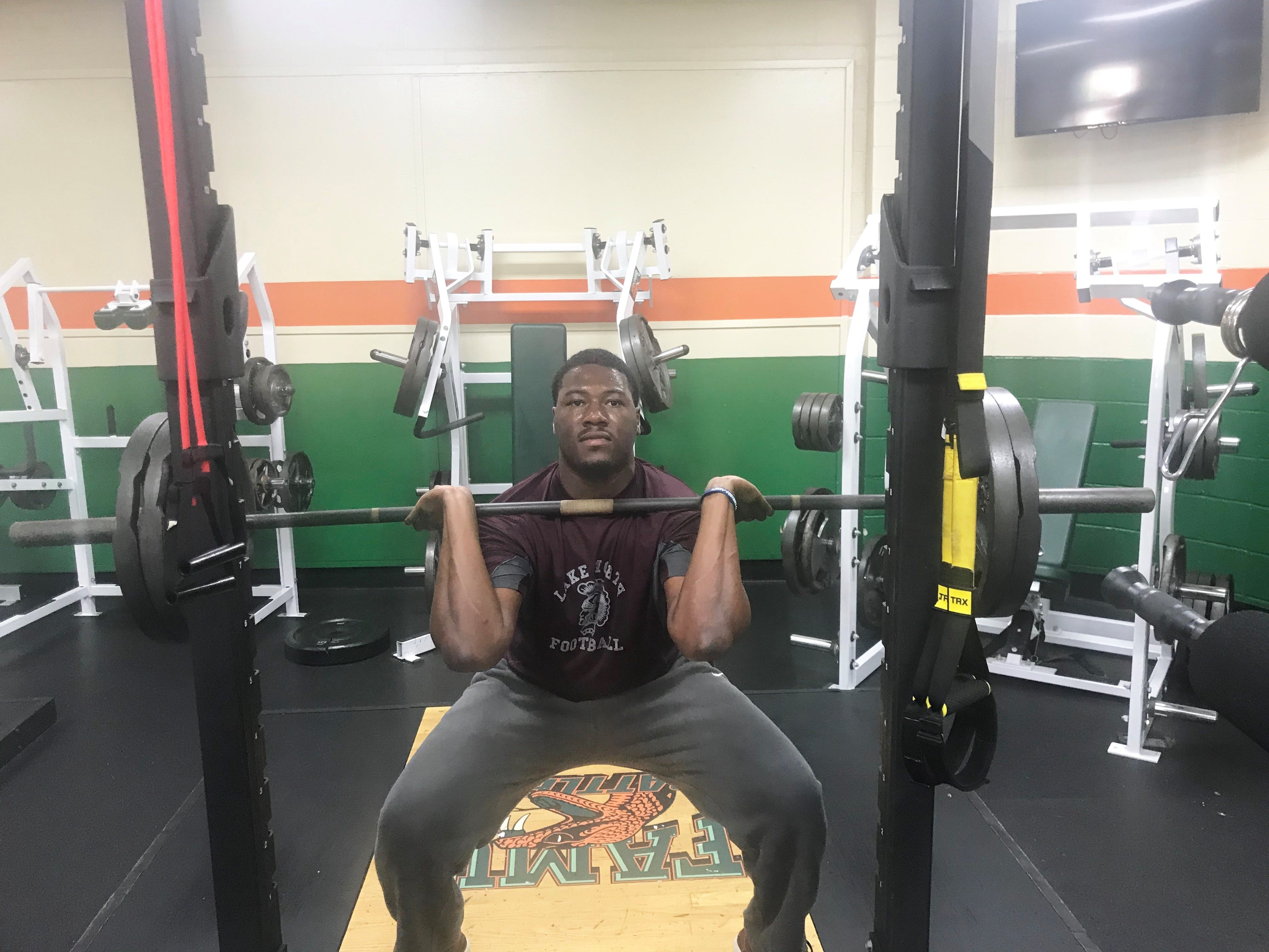 FAMU offensive lineman Tariq Akbar lifts 225-pound front squat.