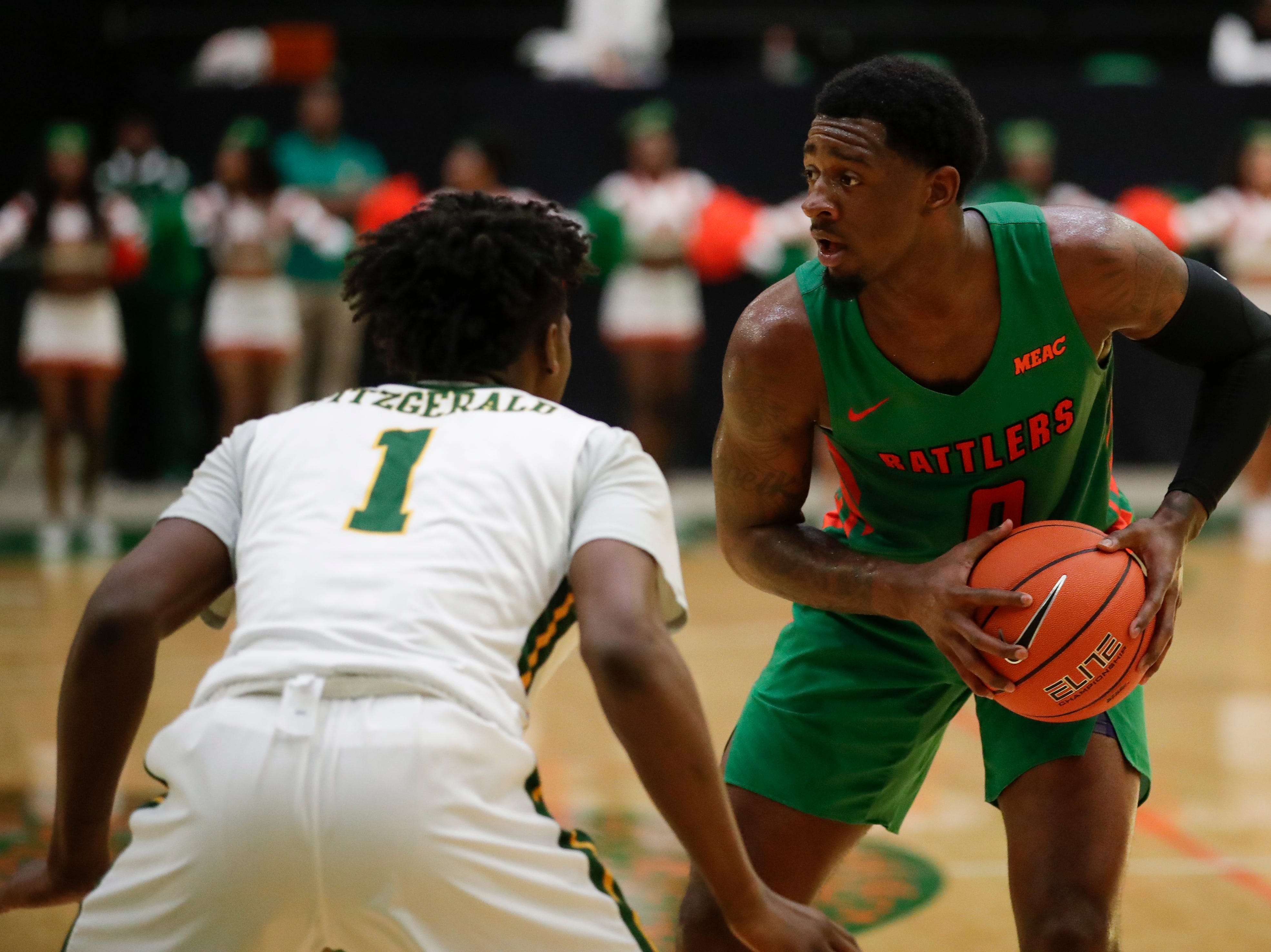 Florida A&M Rattlers forward Tracy Hector Jr. (0) looks for an opening during a game between FAMU and Norfolk State at the Alfred Lawson Jr. Multipurpose Center Monday, Feb. 11, 2019.