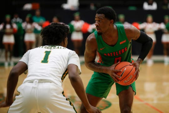 Florida A&M forward Tracy Hector Jr. (0) looks for an opening during a game versus Norfolk State at the Al Lawson Multipurpose Center on Monday, Feb. 11, 2019.