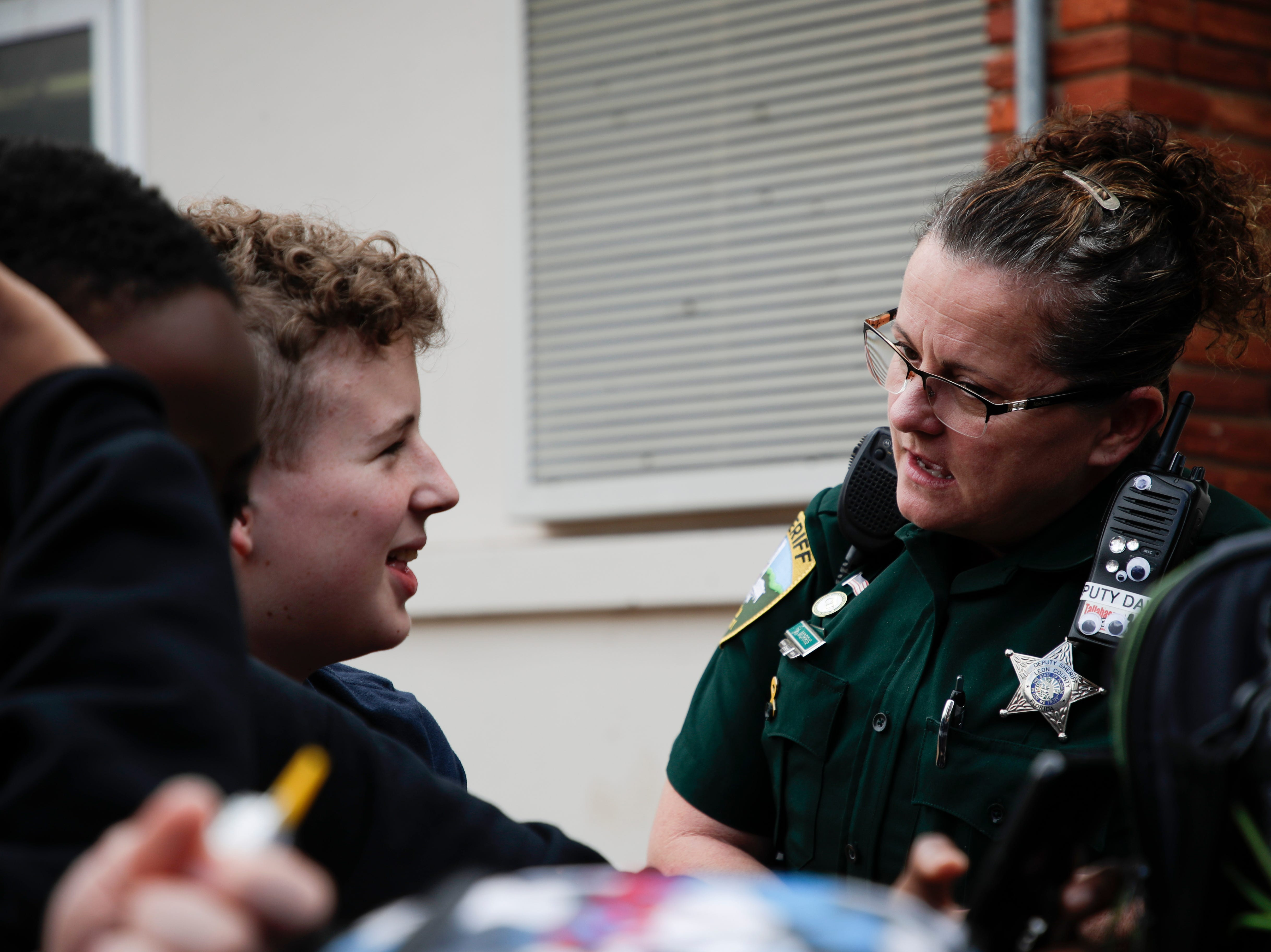 Leon County Sheriff's Department Deputy Jennifer Morris, school resource officer at Cobb Middle School, talks with seventh grader Bobby Elliot during lunch Tuesday, Feb. 12, 2019.