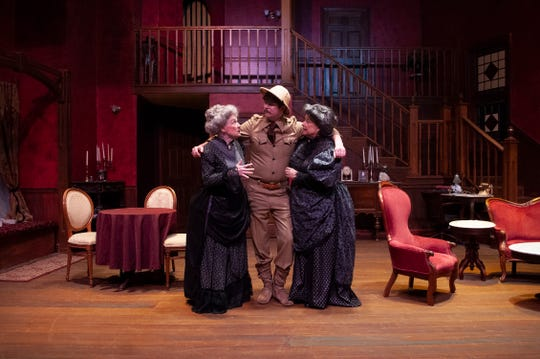 """Teddy Brewster (Tom Sheehan) believes he's Theodore Roosevelt. His aunts, Abby (Beth Blair, left) and Martha (Debbie Frost), humor him in Theatre Tallahassee's """"Arsenic and Old Lace."""""""