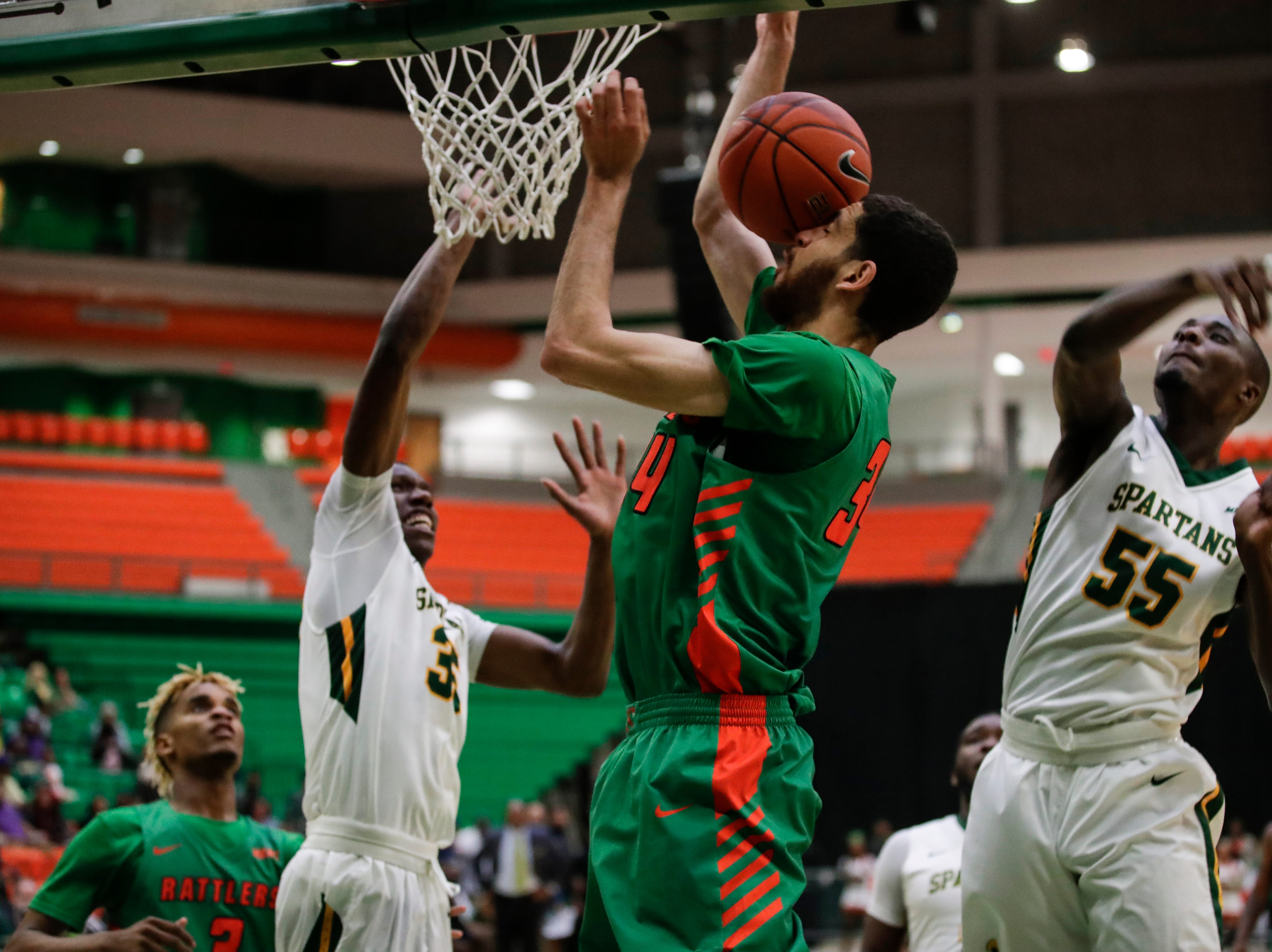 Florida A&M Rattlers center Isaiah Martin (34) gets a shot blocked during a game between FAMU and Norfolk State at the Alfred Lawson Jr. Multipurpose Center Monday, Feb. 11, 2019.