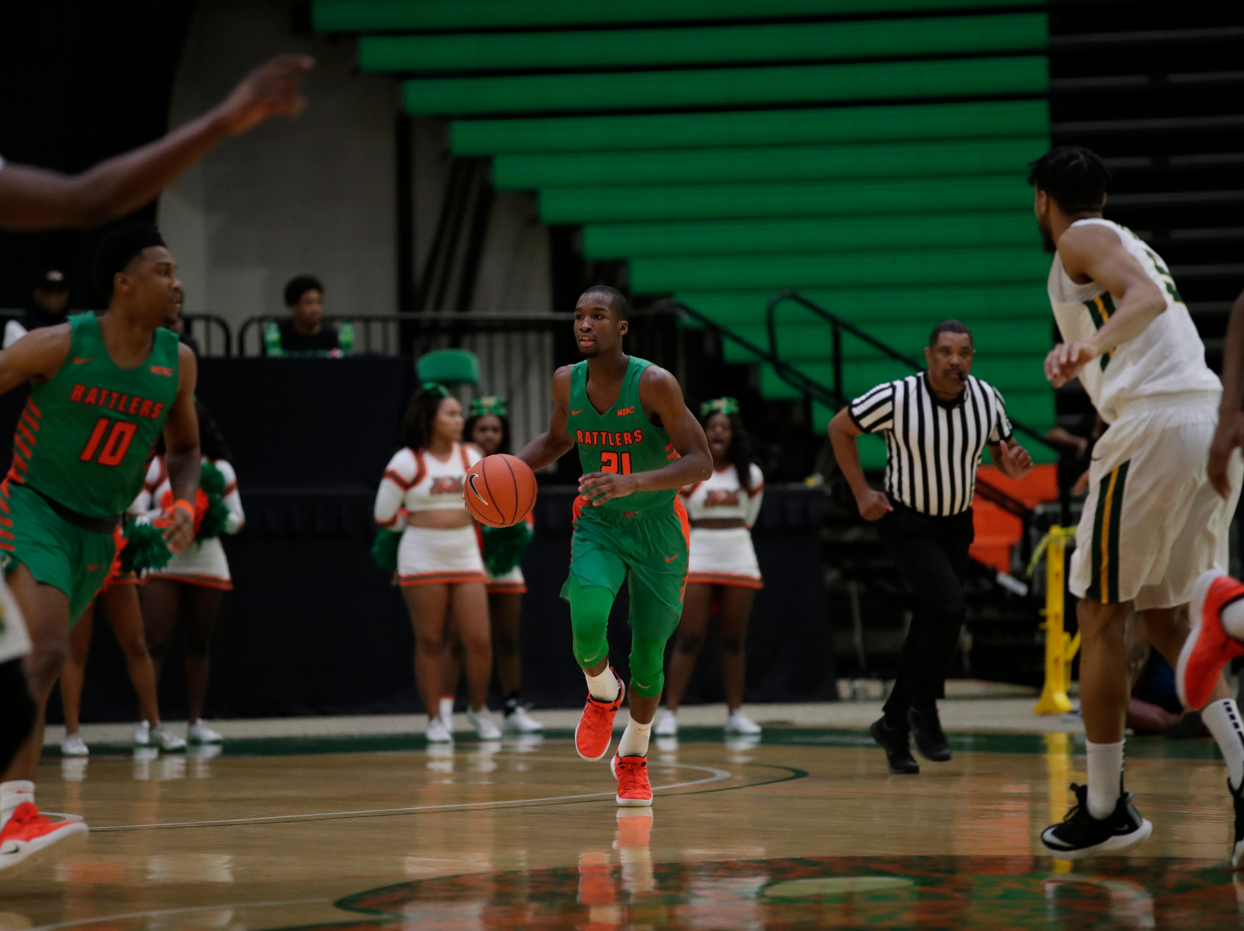Florida A&M Rattlers guard Justin Ravenel (21) brings the ball up during a game between FAMU and Norfolk State at the Alfred Lawson Jr. Multipurpose Center Monday, Feb. 11, 2019.