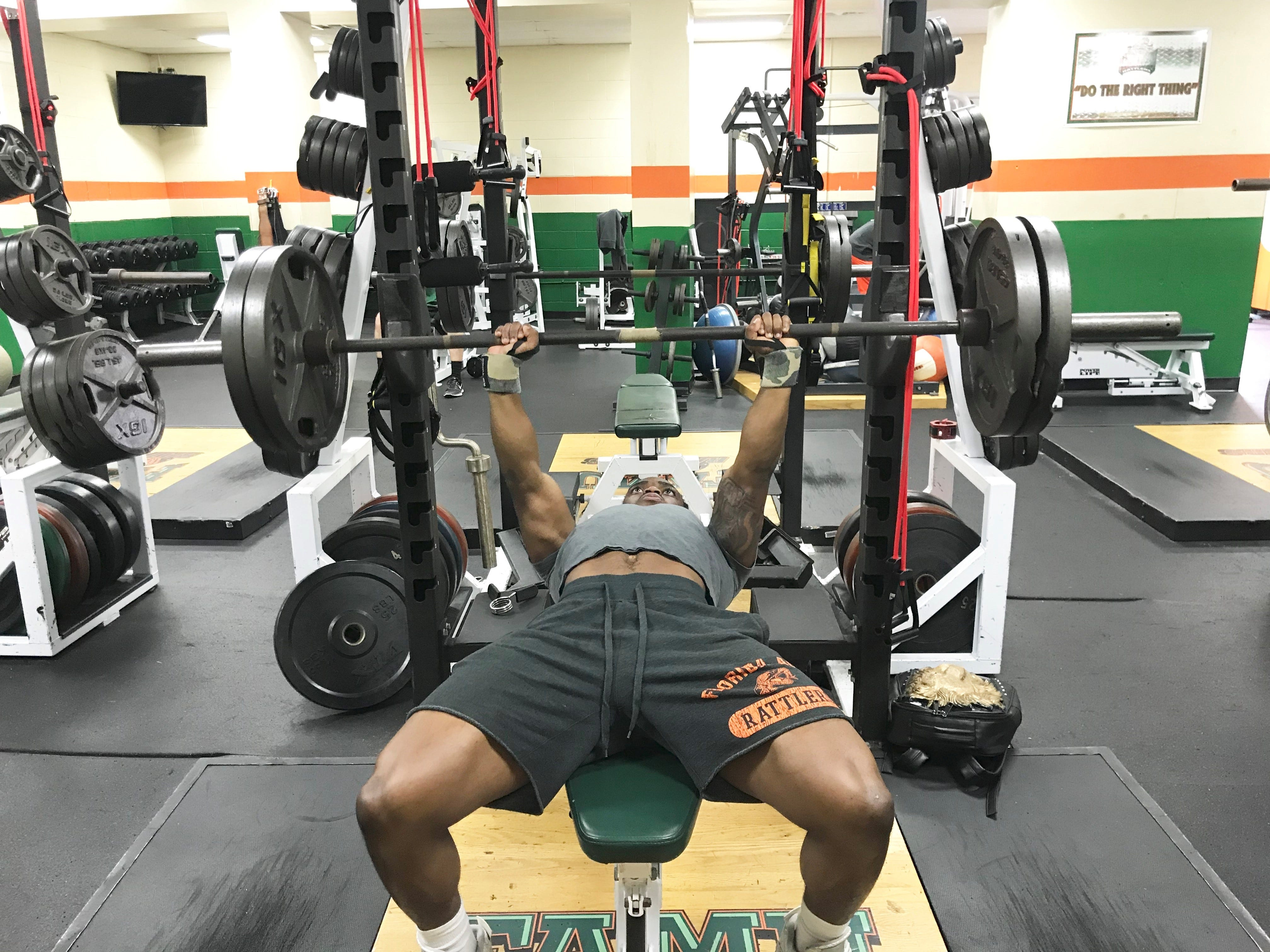 Running back Eddie Tillman trains for the 2019 season with a 225-pound bench press to begin his workout.