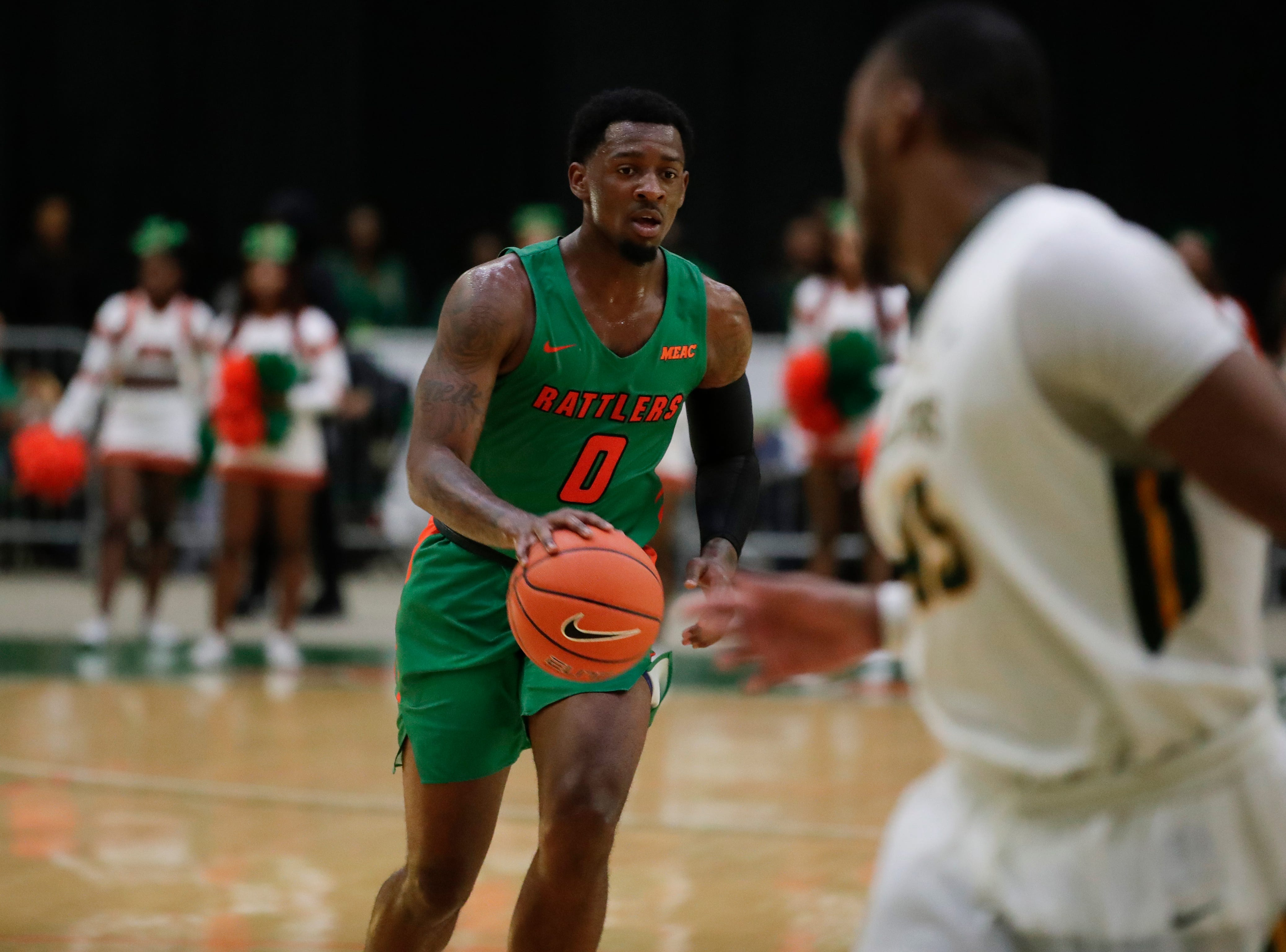 Florida A&M Rattlers forward Tracy Hector Jr. (0) dribbles during a game between FAMU and Norfolk State at the Alfred Lawson Jr. Multipurpose Center Monday, Feb. 11, 2019.