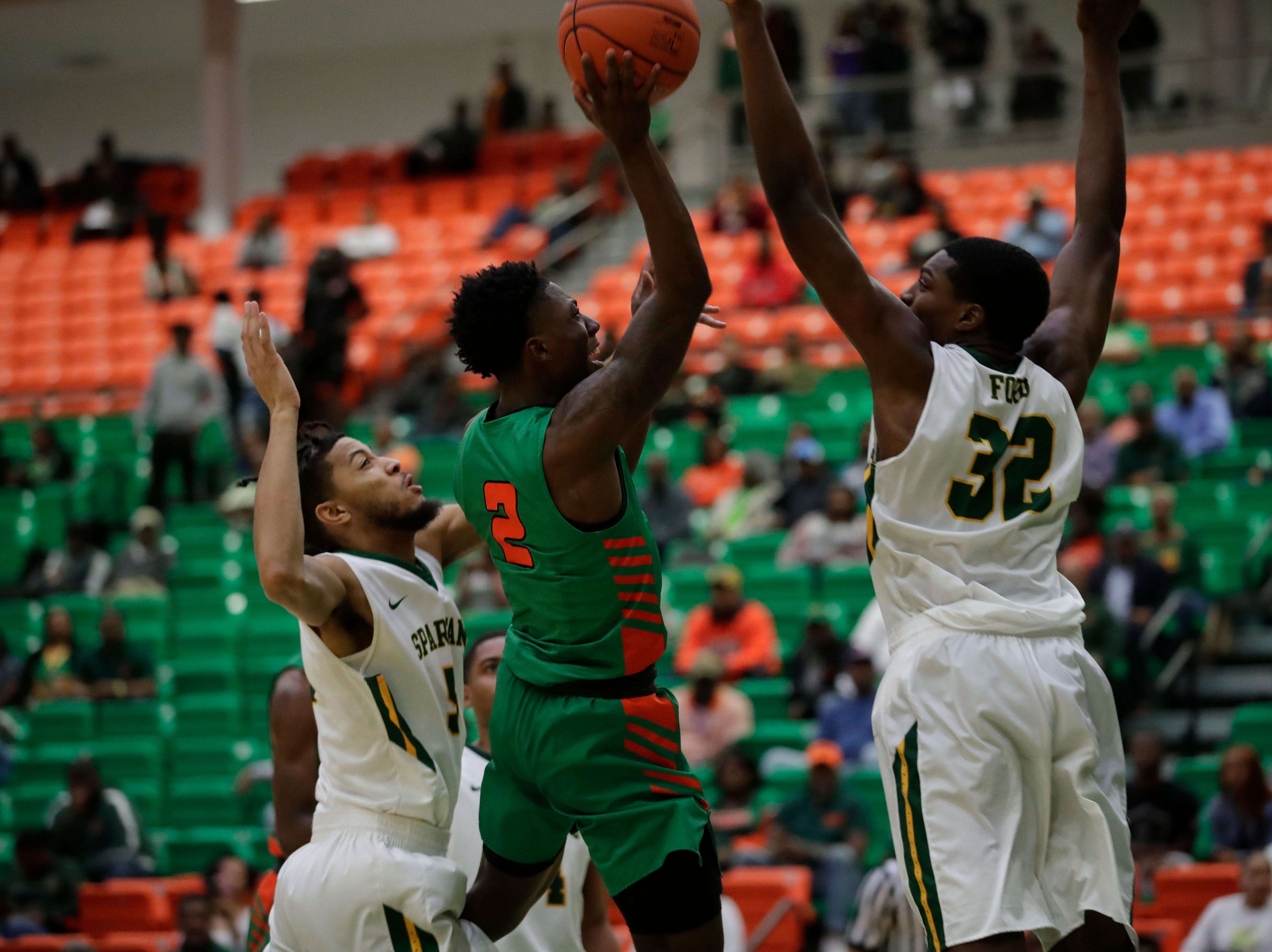 Florida A&M Rattlers guard Kamron Reaves (2) shoots over a double team by Norfolk State at the Alfred Lawson Jr. Multipurpose Center Monday, Feb. 11, 2019.