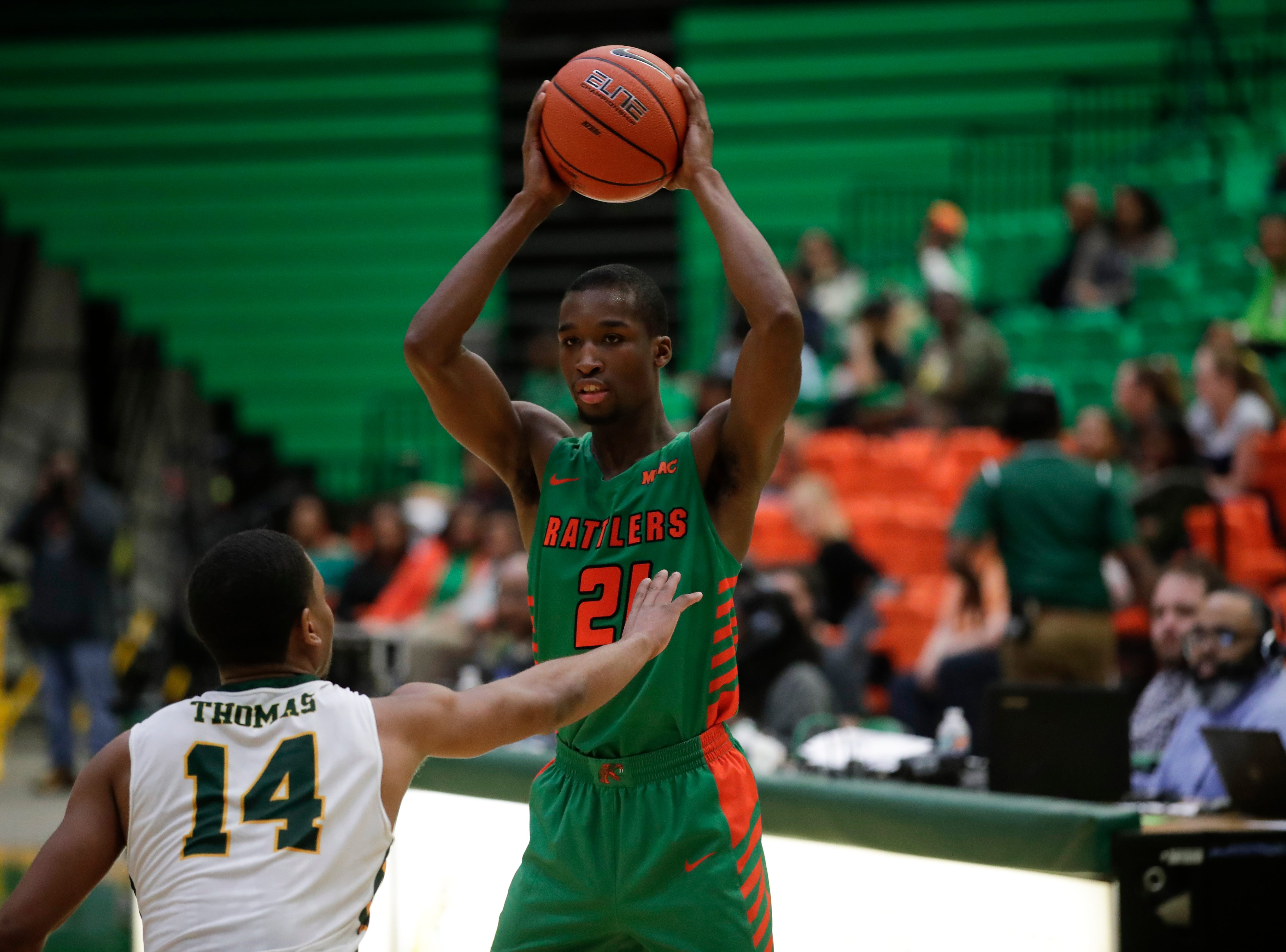 Florida A&M Rattlers guard Justin Ravenel (21) looks for an opening during a game between FAMU and Norfolk State at the Alfred Lawson Jr. Multipurpose Center Monday, Feb. 11, 2019.