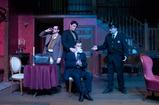 """Officer O'Hara (Bob Myers) interrupts Dr. Einstein's (Nathan Williamson) and Jonathan's (Jeff Hoh) plans for Mortimer (David Sloan, seated) in Theatre Tallahassee's """"Arsenic and Old Lace."""""""