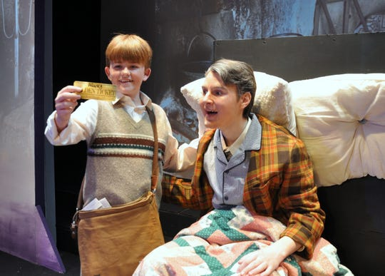 """Charlie Bucket (Grantham Durham) and Grandpa Joe (Tyler Barringer) delight in discovering a Golden Ticket in the Young Actors Theatre production of """"Willy Wonka: The Musical."""""""