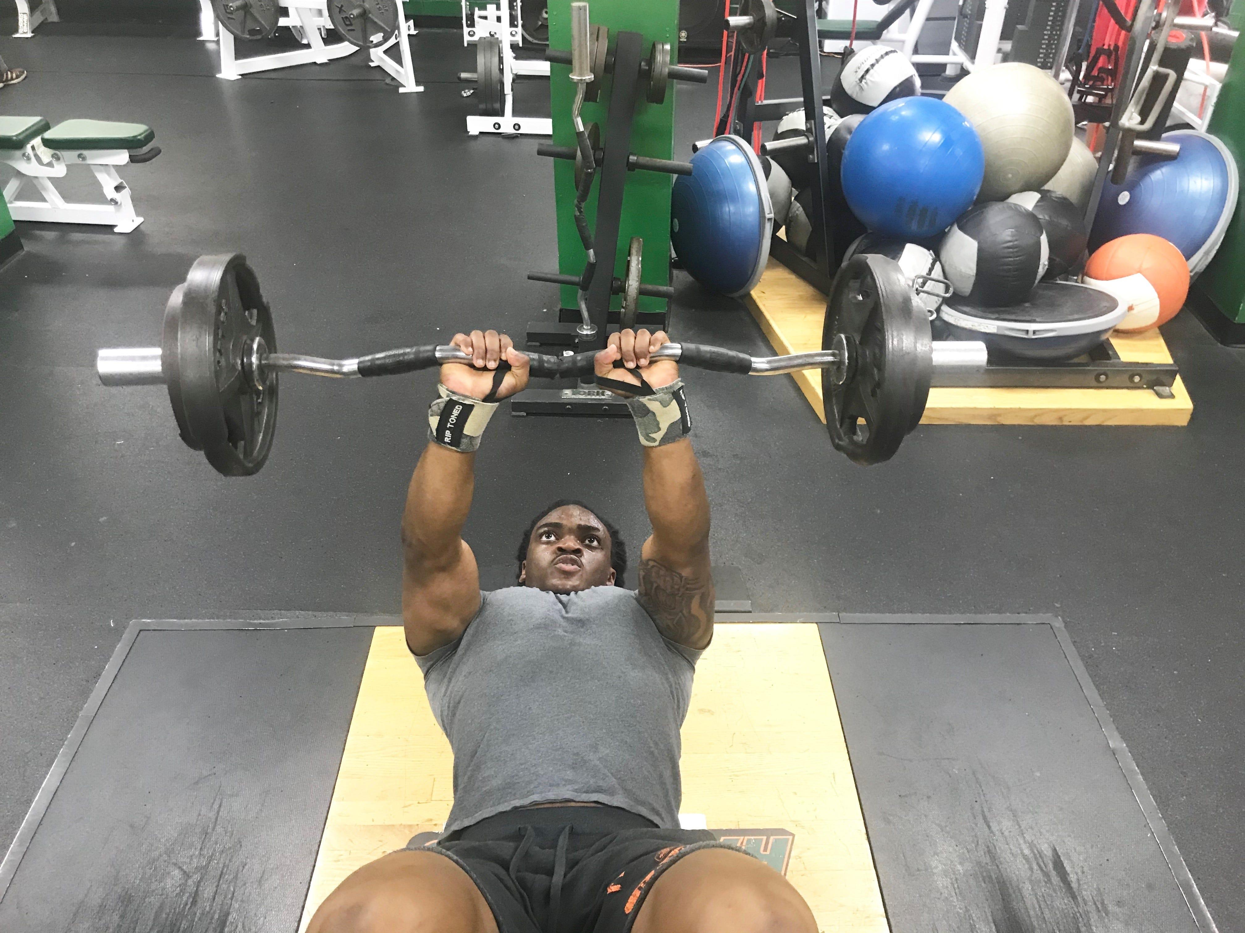 FAMU running back Eddie Tillman lifts 95 pounds on the skull crushers.
