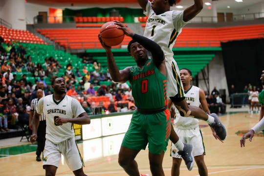 Florida A&M Rattlers forward Tracy Hector Jr. (0) takes a body during a game between FAMU and Norfolk State at the Alfred Lawson Jr. Multipurpose Center Monday, Feb. 11, 2019.
