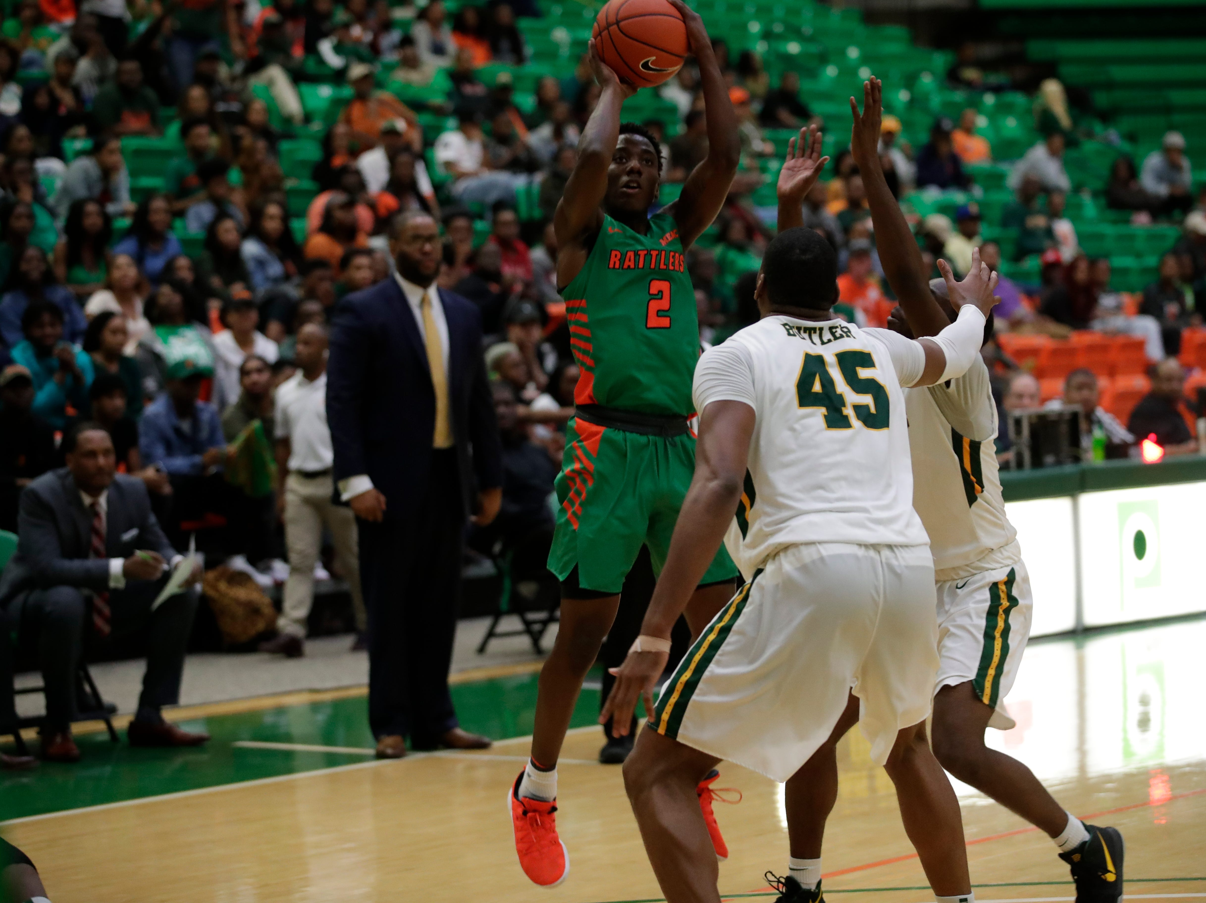 Florida A&M Rattlers guard Kamron Reaves (2) shoots during a game between FAMU and Norfolk State at the Alfred Lawson Jr. Multipurpose Center Monday, Feb. 11, 2019.