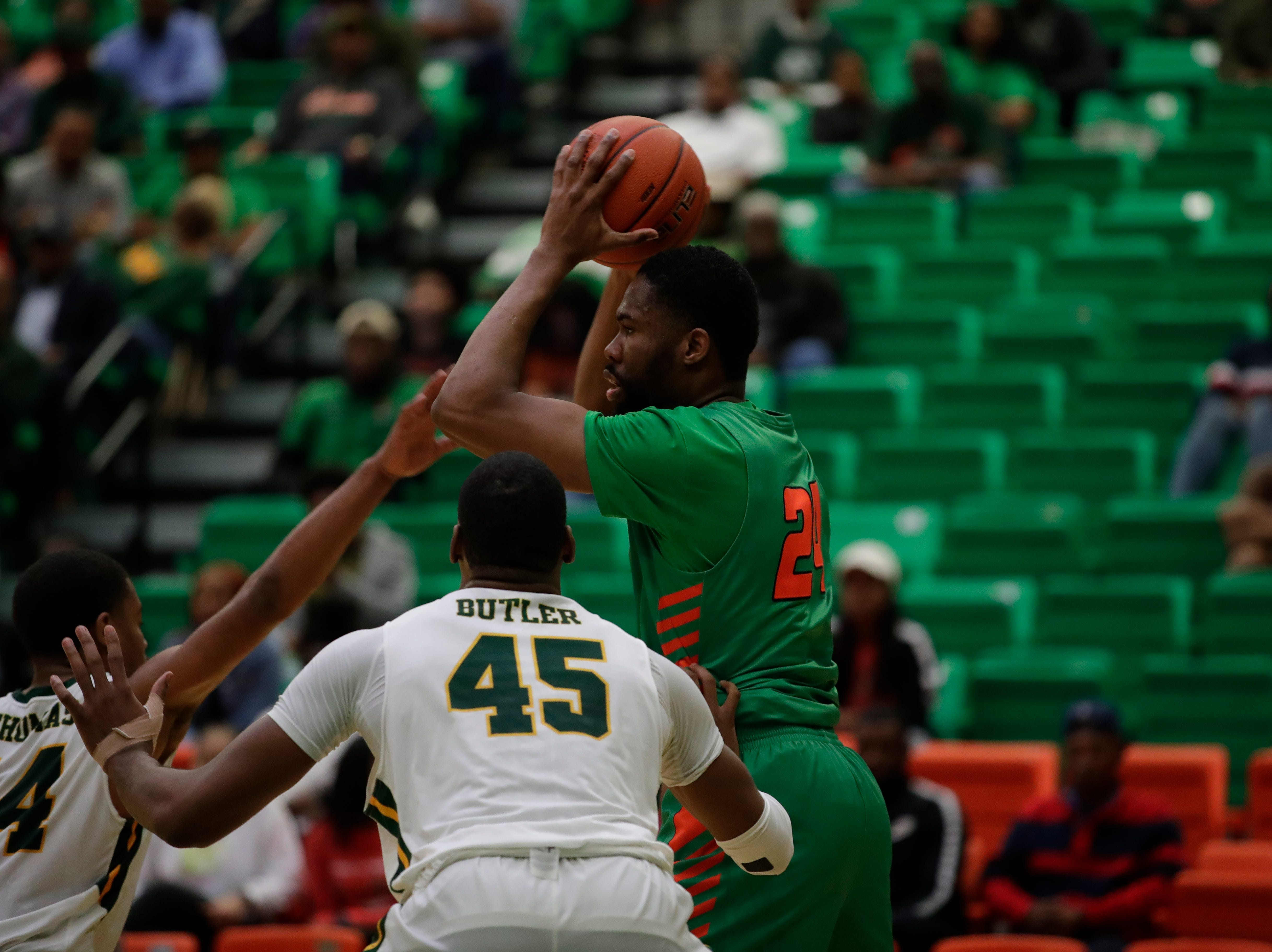 Florida A&M Rattlers forward Ifeanyi Umezurike (24) looks to pass during a game between FAMU and Norfolk State at the Alfred Lawson Jr. Multipurpose Center Monday, Feb. 11, 2019.