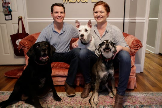 Jason and Sandi Poreda met in 2008 at Tom Brown Park when they were each walking their dogs, Brady, left, who was Jason's and Charley, right, who was Sandi's. Since then, they have shared their love with many canine friends including Ella, center, who they adopted together.