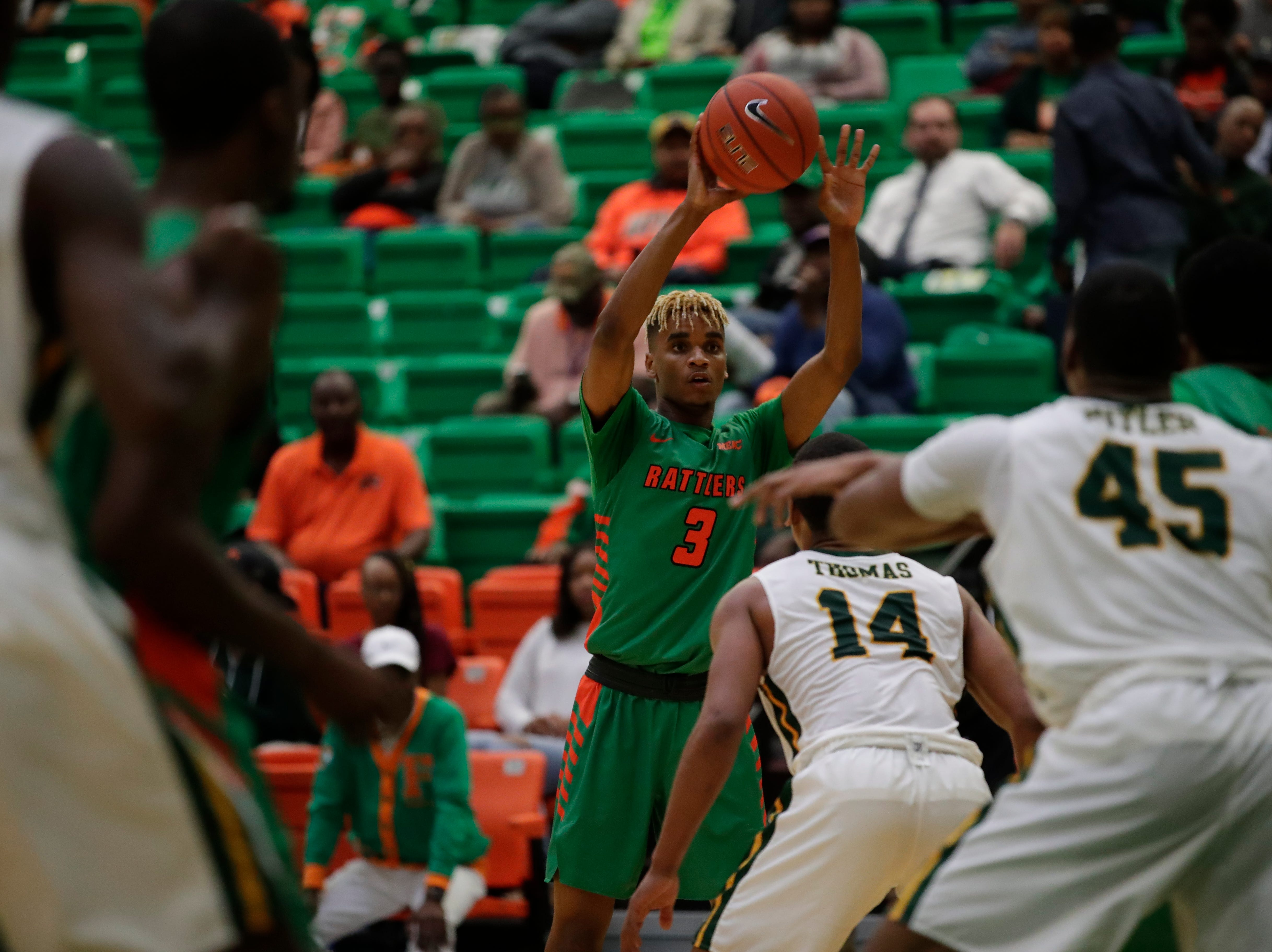Florida A&M Rattlers guard MJ Randolph (3) makes a pass during a game between FAMU and Norfolk State at the Alfred Lawson Jr. Multipurpose Center Monday, Feb. 11, 2019.