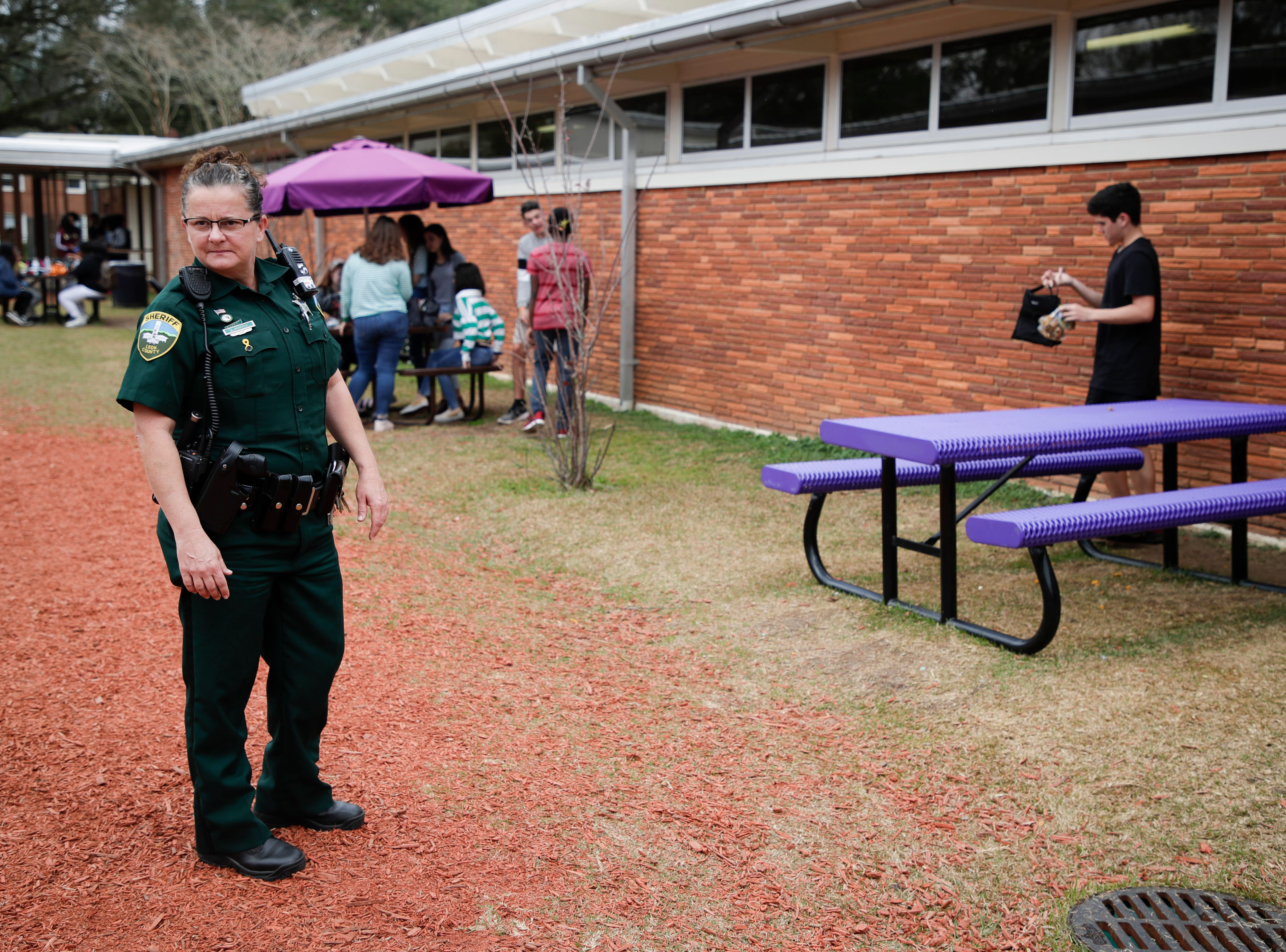Leon County Sheriff's Department Deputy Jennifer Morris, hangs out where students are eating lunch outside Tuesday, Feb. 12, 2019.